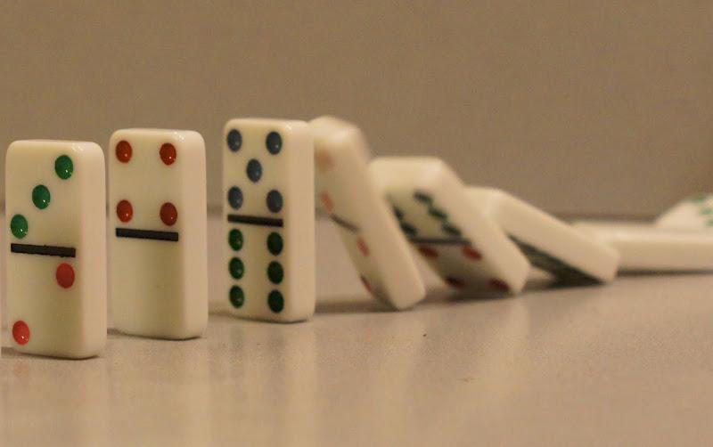 dominoes falling