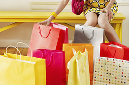 woman with shopping bags - compulsive overshopping