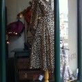 leopard trench in store window